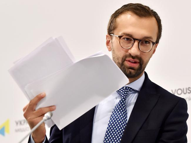 Ukrainian journalist and member of parliament Serhiy Leshchenko holds pages showing allegedly signings of payments to Donald Trump's presidential campaign chairman Paul Manafort from an illegal shadow accounting book of the party of former Ukrainian president Viktor Yanukovych. Picture: AFP