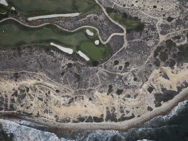 A golf course stands next to the Pacific Ocean in this aerial photograph taken over Rancho Palos Verdes, California in August last year. Picture: Patrick T. Fallon/Bloomberg via Getty Images