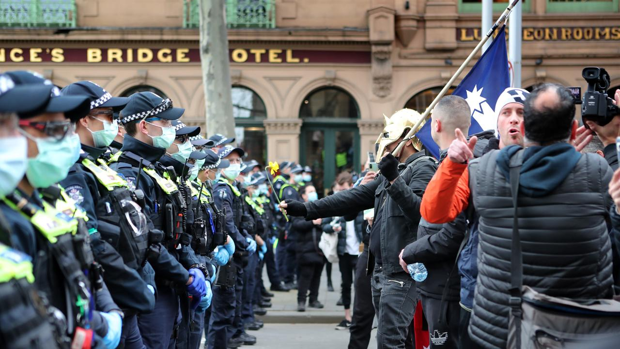 Protesters against the police line outside Flinders Street Station. Picture Rebecca Michael.