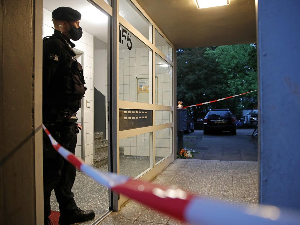 Police stand outside an apartment building where five children were found dead. Picture: Andreas Rentz/Getty Images