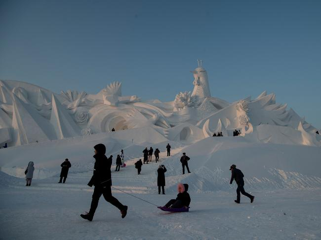Beyond the sculpture displays, visitors get involved in competitions and carnival activities. Picture: Chinatopix via AP