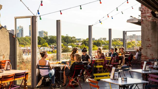 Just north of the CBD, Fitzroy and its neighbour, Brunswick, are teeming with quirky bars (like the ever-popular rooftop bar at Naked in the Sky or the institution that is Bimbo's that serves $5 pizza for the win) and tiny restaurants to recover at the day after. Picture: Visit Victoria / Josie Withers