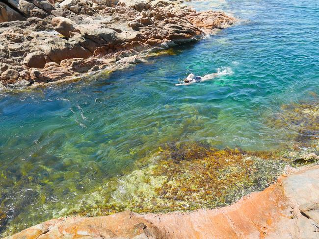 SWIM IN THE AQUARIUM Tucked away in a nook protected by rocks and the surf is a crystal clear lagoon known as Yallingup's aquarium. Spend the day snorkelling, following fish, catching crabs and of course, taking photos for the 'gram.