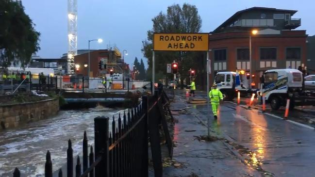 Flood clean up in Market Place and Collins st, Hobart