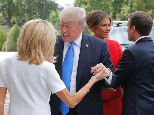 """""""You can let go any time, Monsieur Trump. No need to drag this out."""" Picture: Michel Euler"""
