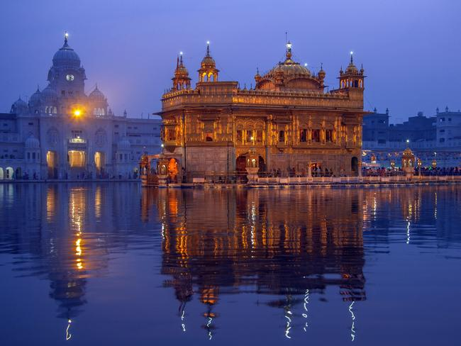 GOLDEN TEMPLE, AMRITSAR, PUNJAB: The holiest shrine of Sikhism sits in the middle of a sacred lake. Built in the 16th century, the shrine's magnificent dome is covered with 100kg of gold, and inside, the world's largest kitchen serves meals for the thousands of Sikh pilgrims who visit daily. For the full Amritsar experience, G Adventures' Northern India tour combines a daytime visit to the Golden Temple with the quirky spectacle of the formal India-Pakistan Wagah border ceremony in the evening.  gadventures.com.au
