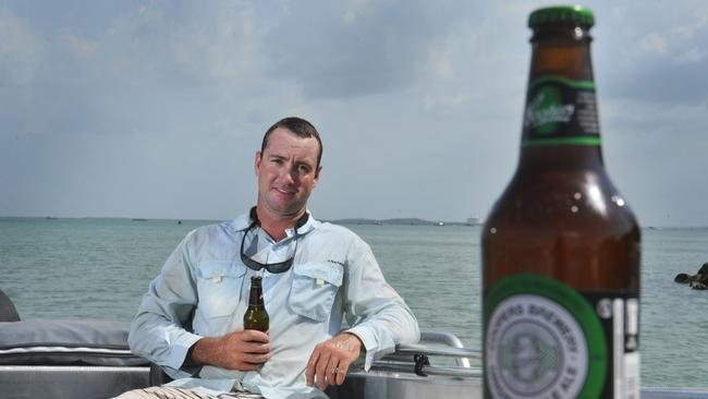 Jay Anderson  enjoys a beer on his boat near Dinah Beach in Darwin. The Territory Government intends to introduce a floor price on alcohol and alcohol blood limits for boat drivers. Picture: Helen Orr