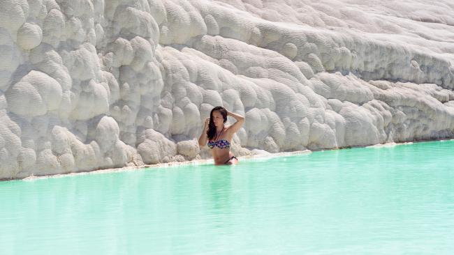 37/41Pamukkale - Denizli, Turkey One of the most visually striking natural wonders in Turkey, the Pamukkale travertines (travertines meaning terraces of carbonate) is also one of the most fun. Flowing with thermal waters that head into 17 different springs, of which some are swimming temperature, Pamukkale has attracted visitors for over a thousand years. One of the most surreal experiences might not actually be soaking on the steps, but in fact the chance to swim in the 'sacred pool', where you'll be floating past ancient Roman columns and sculptures. This is just a taster of the fascinating ancient sights to discover in the area.