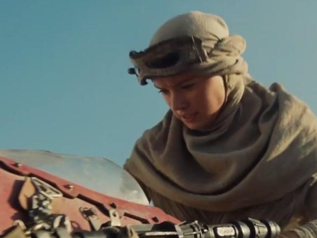 Female lead ... Rey on her Speeder in the desert.