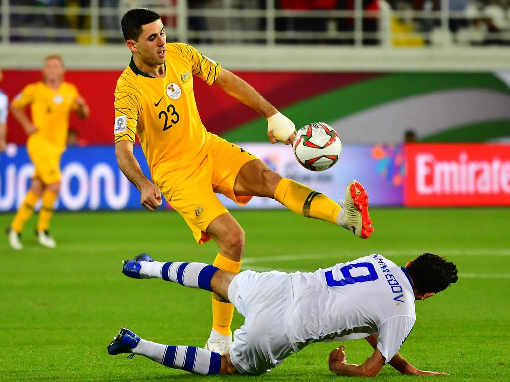 Australia's forward Tomas Rogic (L) vies for the ball with Uzbekistan's midfielder Odil Akhmedov during the 2019 AFC Asian Cup Round of 16 football match between Australia and Uzbekistan at the Khalifa bin Zayed Stadium in Al-Ain on January 21, 2019. (Photo by Giuseppe CACACE / AFP)