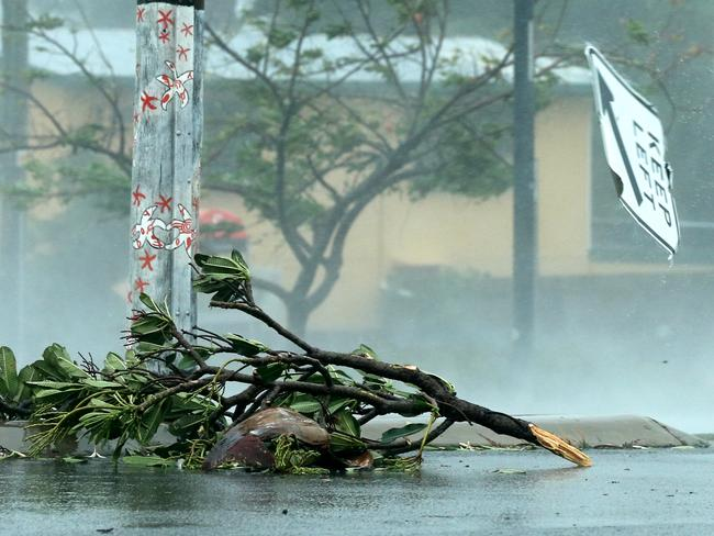A keep left sign flies down the street after being ripped from its post in the main street of Bowen. Picture: Lyndon Mechielsen/The Australian