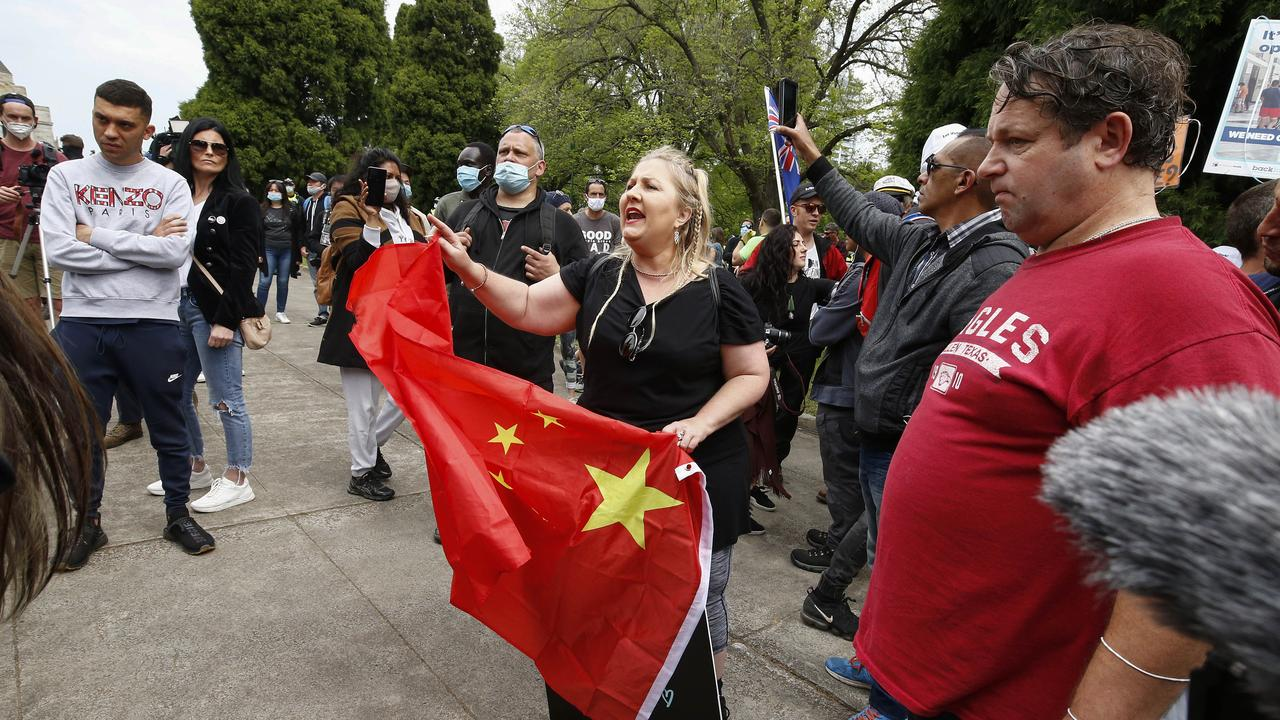 A woman holds a Chinese flag at an anti-lockdown protest in Melbourne. Picture: Daniel Pockett/NCA NewsWire