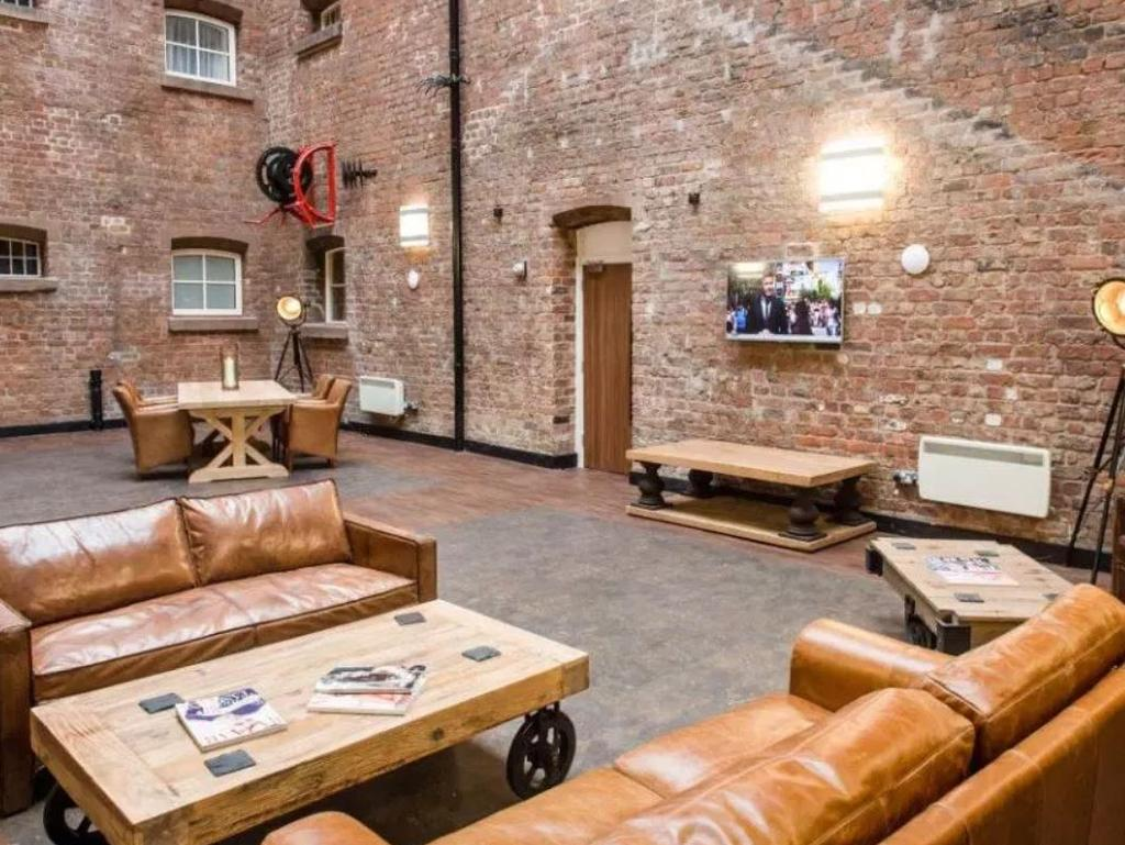 The exercise yard has been converted into a light and airy lounge area. Picture: Bridewell Prison Hotel