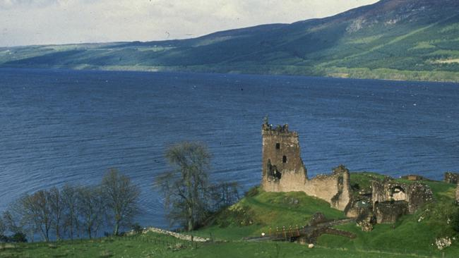 ** HOLD FOR RELEASE UNTIL 6:01 P.M. TUESDAY (2301GMT TUESDAY). THIS PHOTO MAY NOT BE POSTED ONLINE, BROADCAST OR PUBLISHED BEFORE 6:01 P.M. TUESDAY (2301GMT TUESDAY) ** FILE ** The undated file photo shows Scotland's 23-mile long Loch Ness, home of the elusive monster, Nessie. In foreground is Urquhart Castle. The Grand Canyon, Loch Ness and Niagara Falls are among over 200 natural sites competing to become the New 7 Wonders of Nature in a global poll that is expected to draw around a billion voters, organizers said Wednesday. The 261 nominees from 222 countries around the world include some of the most famous mountain peaks, lakes, national parks or reefs, such as Mount Everest or the Great Barrier Reef. (AP Photo)