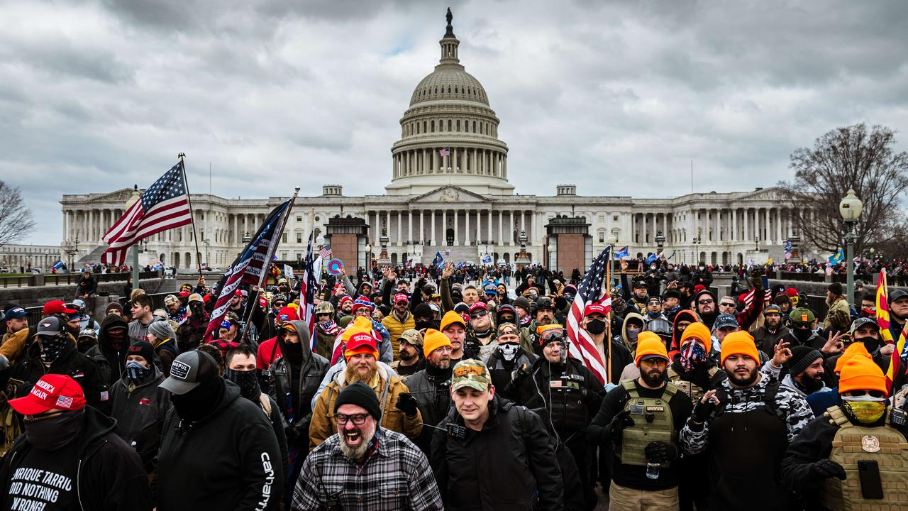 A pro-Trump mob stormed the Capitol, breaking windows and clashing with police officers, but now footage is starting to identify them. Picture: Jon Cherry/Getty