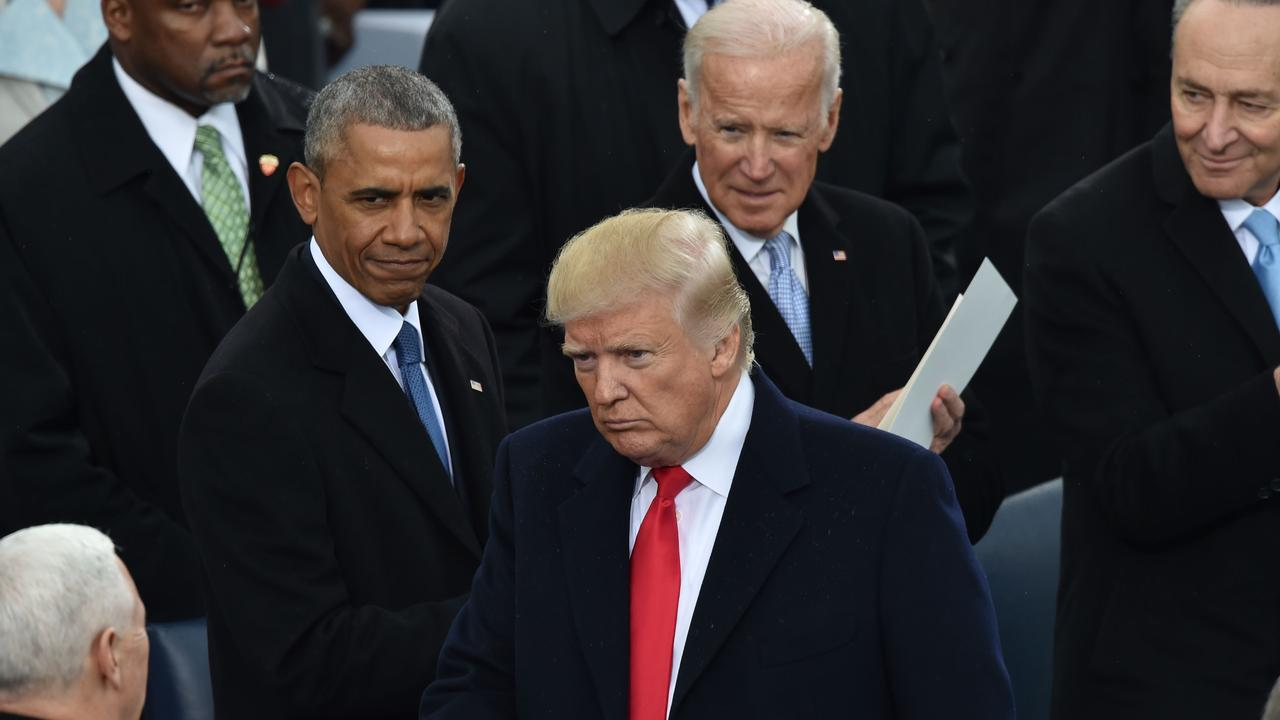 The former, current and perhaps future president at Mr Trumps inauguration in 2017. Picture: Paul Richards/AFP