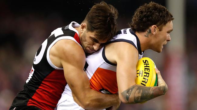 Nathan Wilson is tackled by Koby Stevens on Friday night. (Photo by Adam Trafford/AFL Media/Getty Images)