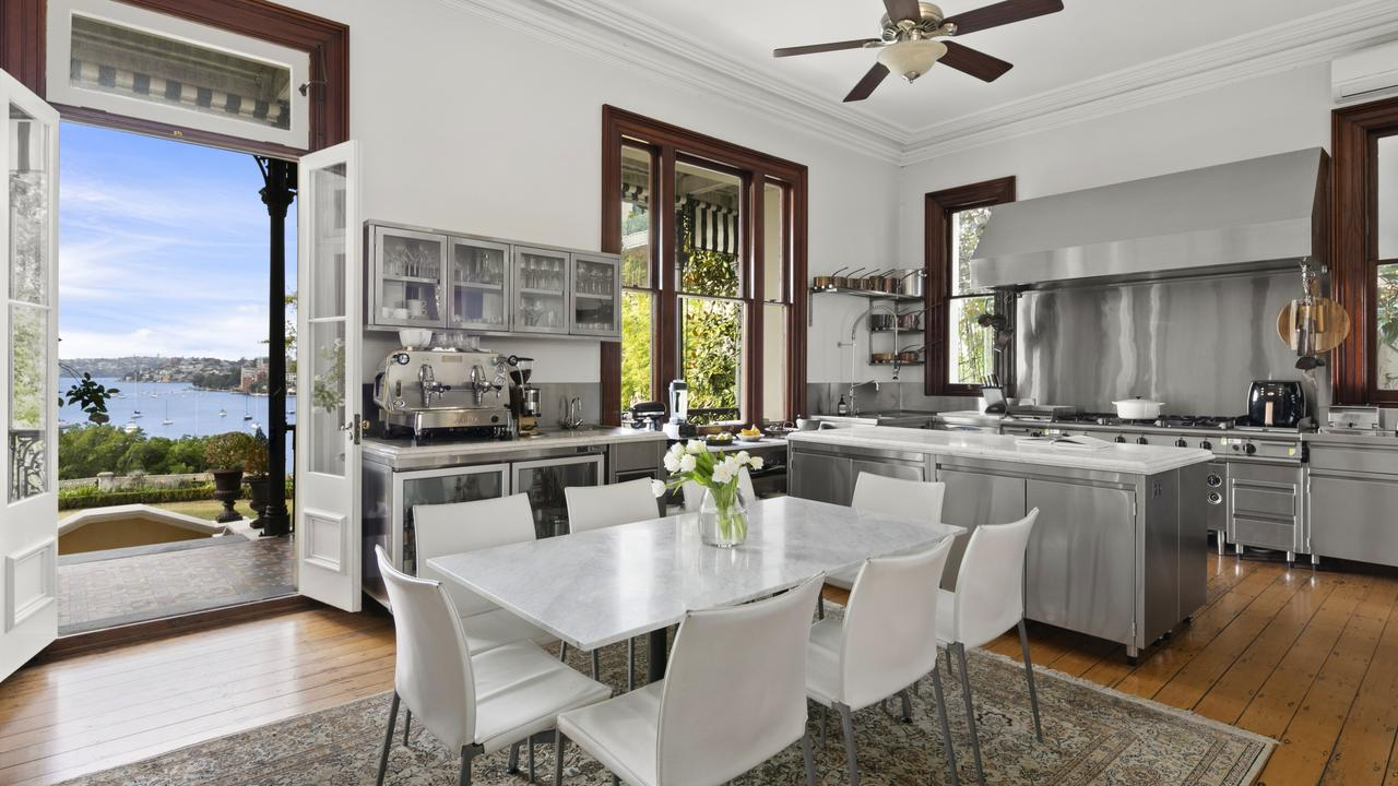 The informal dining room and the kitchen, designed for modern chefs.