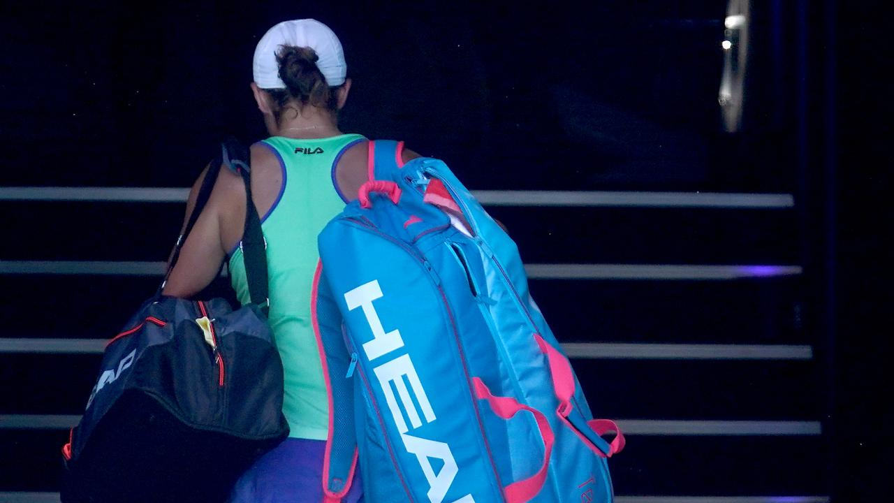 Ashleigh Barty cuts a forlorn figure as she leaves Rod Laver Arena following a heartbreaking semi final defeat.