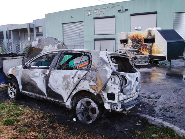 Two cars and a caravan have been destroyed by fire at a Campbellfield repair shop. Picture: Hamish Blair