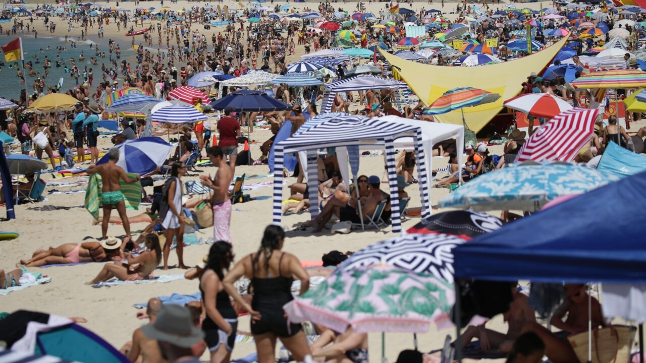 Thousands flock to Bondi Beach to escape Australia Day heat