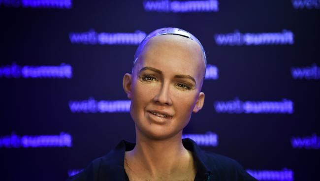 Sophia is not pre-programmed with answers but instead uses machine learning algorithms to form her responses. Picture: Patricia de Melo/AFP