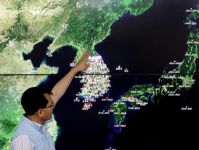 Ryoo Yog-Gyu, a Monotoring director of National Earthquake and Volcano Center, shows seismic waves taking place in North Korea on a screen at the Korea Meteorological Administration center. Picture: Getty