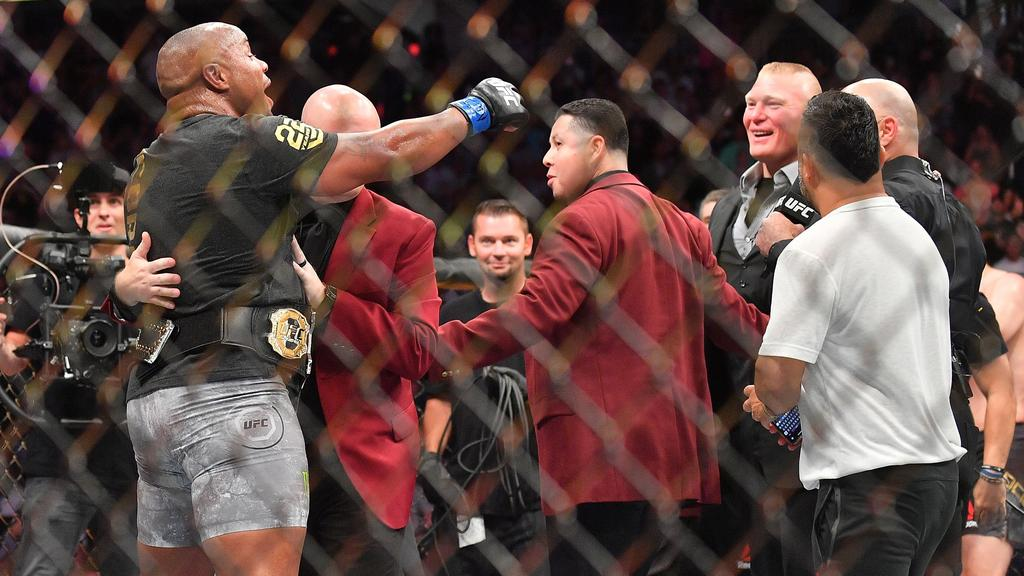 c4176e41e7e Daniel Cormier challenges Brock Lesnar after winning his heavyweight championship  fight against Stipe Miocic in July