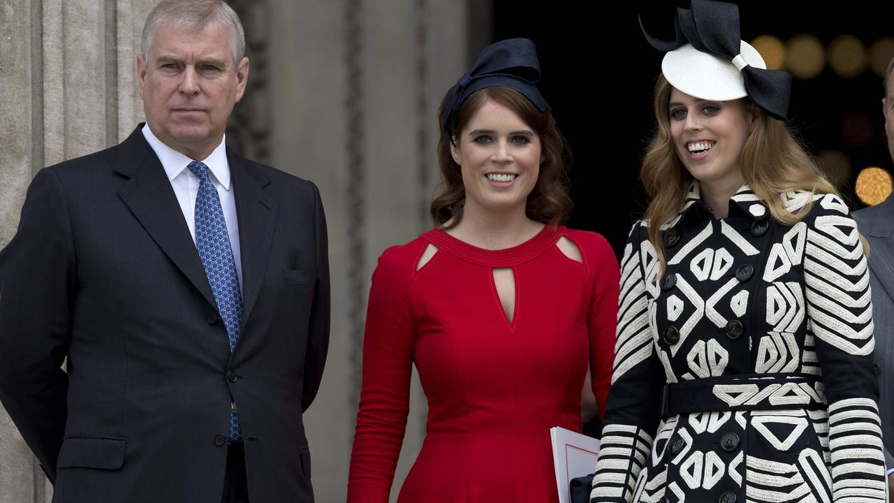Prince Andrew, Princess Eugenie of York and Princess Beatrice of York in 2016. Picture: Justin Tallis / AFP