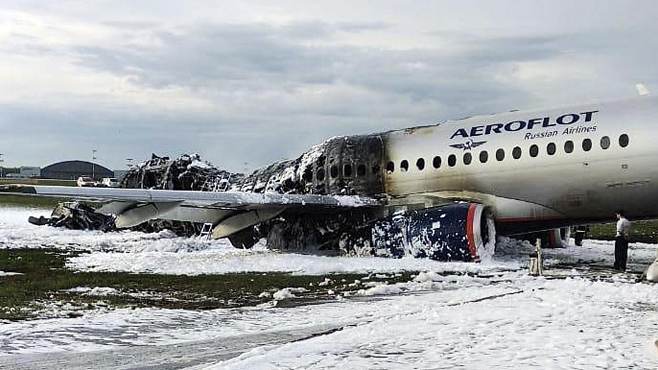 The tail of the aircraft was completely engulfed in flames. Picture: Moscow News Agency photo via AP.