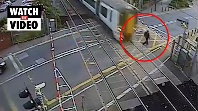 Terrifying moment man almost hit by train
