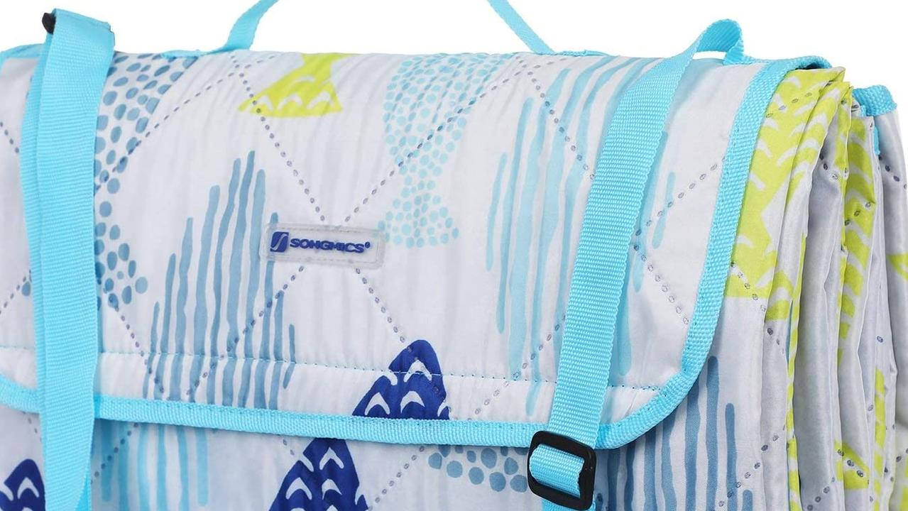 Printed picnic blanket with handles.