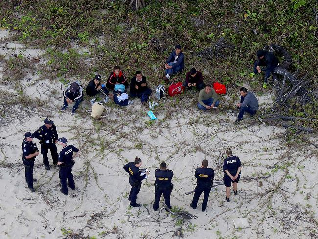 Police and Border Force officers located 11 people but more are thought to be on the run after a fishing boat ran aground Far North Queensland. Picture: Marc McCormack