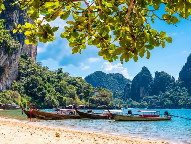 RAILAY BEACH, KRABI Of all the tropical beaches Thailand is known for, one stands out like a sore thumb: Railay Beach. A stunning stretch of paradise that is isolated from the mainland, Railay sits at the bottom of towering, twisted limestone cliffs, surrounded by the warm Andaman Sea. Besides the obvious lazing about, you can choose from a range of more adrenaline-focused activities such as rock climbing, snorkelling, sea kayaking or diving.
