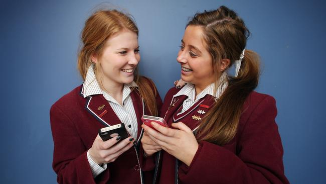 Social networking and teenagers, teens reject the social media risk, from left, Lillian Jones, 18, of Sandy Bay, and Holly Gardner, 18, of North Hobart, prefer chatting face to face