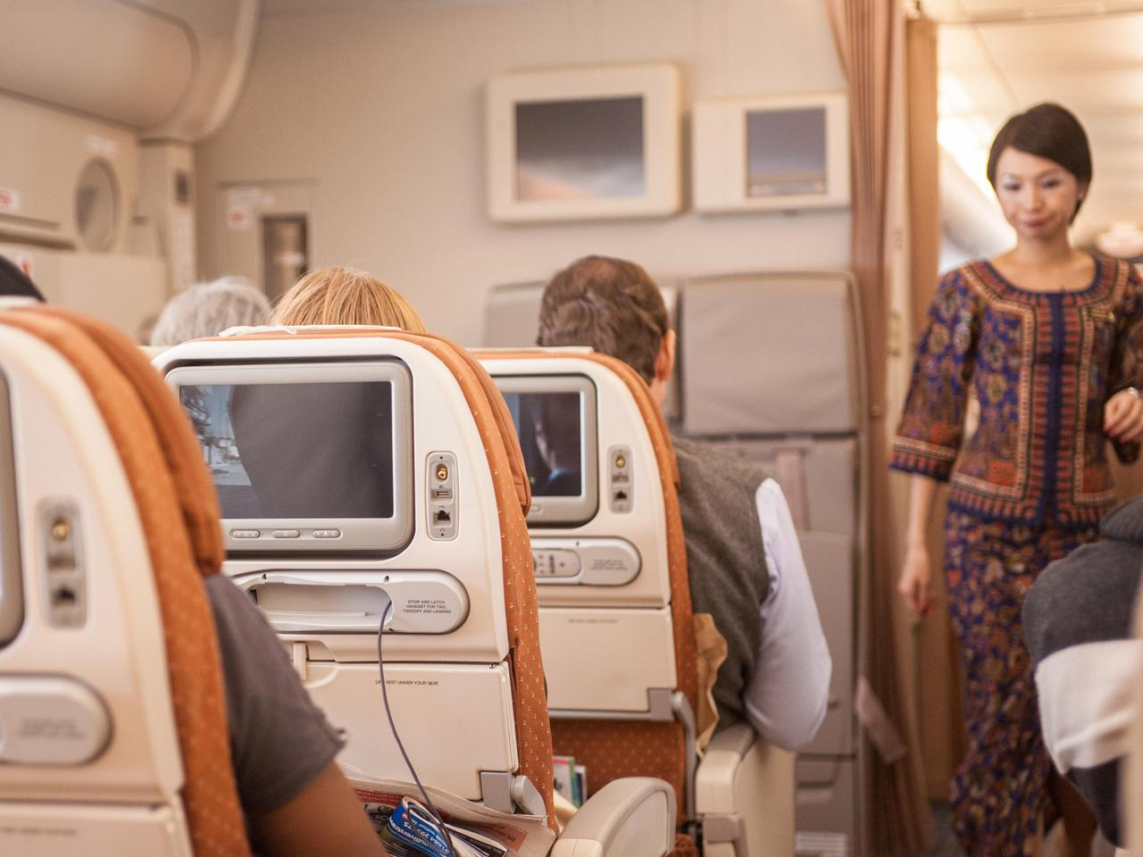 Cabin of A380 double decker Singapore Airlines Airbus at Changi Airport,Singapore leaving for London.female,woman,flight,attendant,staff,young,