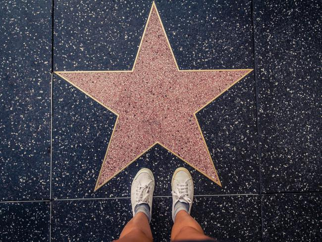 SEE THE STARS The Hollywood Walk of Fame comprises more than 2600 five-pointed terrazzo and brass stars embedded in the sidewalks along 15 blocks of Hollywood Boulevard and three blocks of Vine Street. Star ceremonies are held throughout the year and are free to attend.