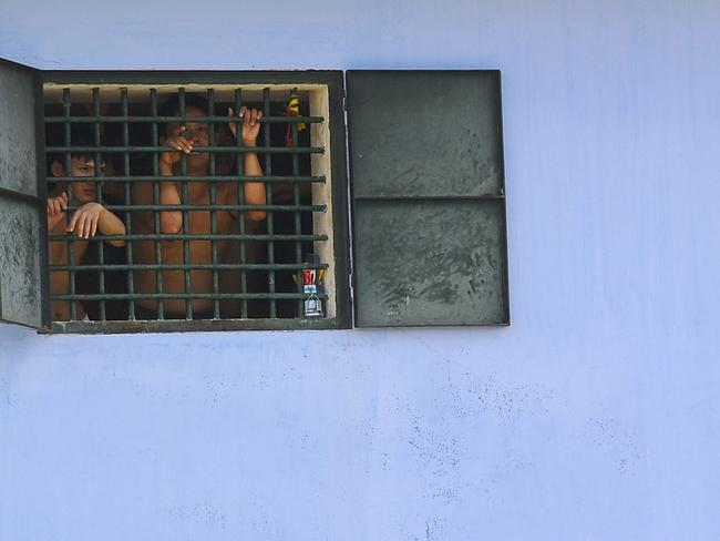 Prisoners at Hoang Tien prison in the Chi Linh district. A conservative estimate puts the current number of political prisoners in Vietnam at 84.  Picture: AFP/HOANG DINH Nam
