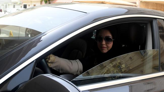 Daniah al-Ghalbi, a newly-licensed Saudi woman driver, sits in her car during a test-drive in the Red Sea resort of Jeddah. Picture: AFP