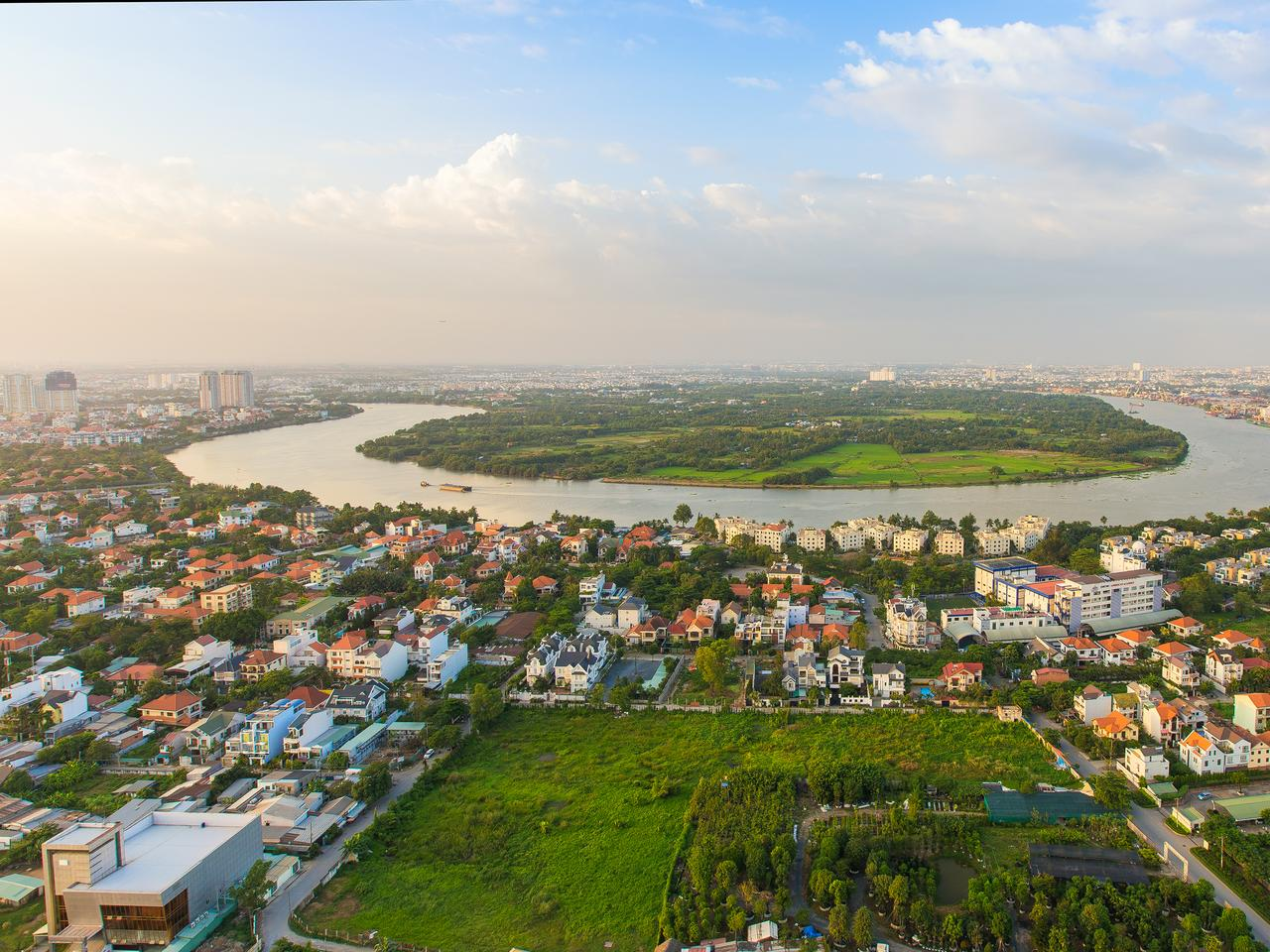 Panoramic view of Thanh Da peninsula on Saigon river , Ho Chi Minh city (or Saigon) in sunset, Vietnam.