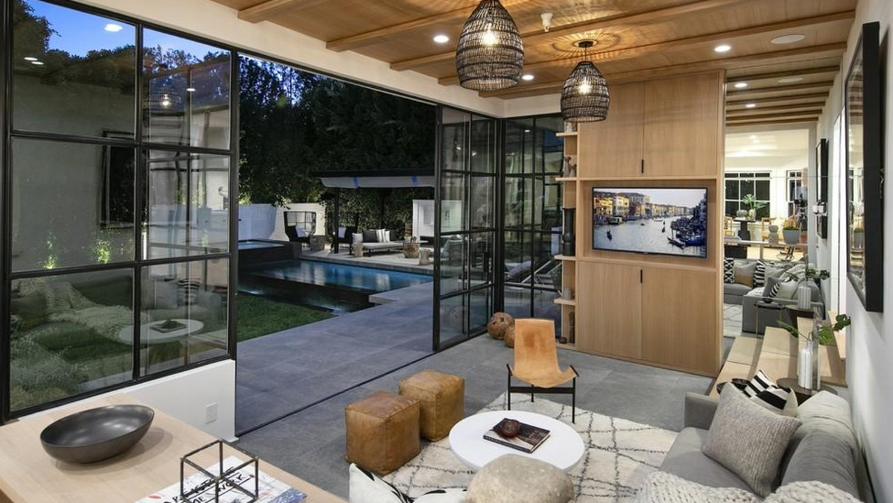 The sunken lounge that leads to the outdoor area. Picture: Realtor
