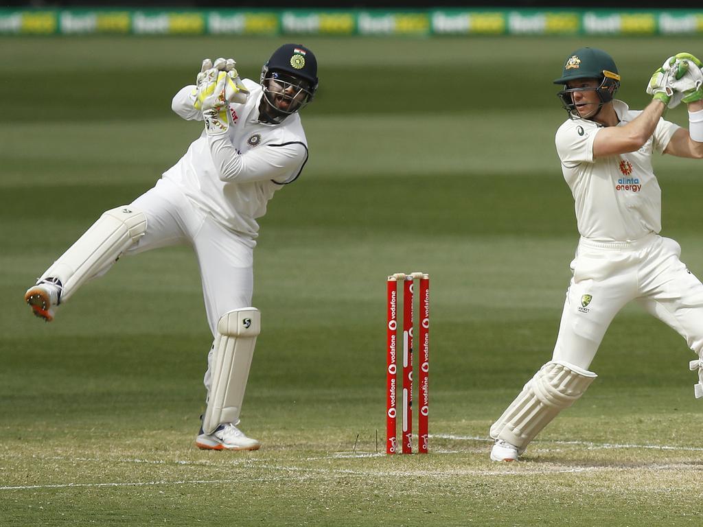 Rishabh Pant of India catches out Tim Paine of Australia.