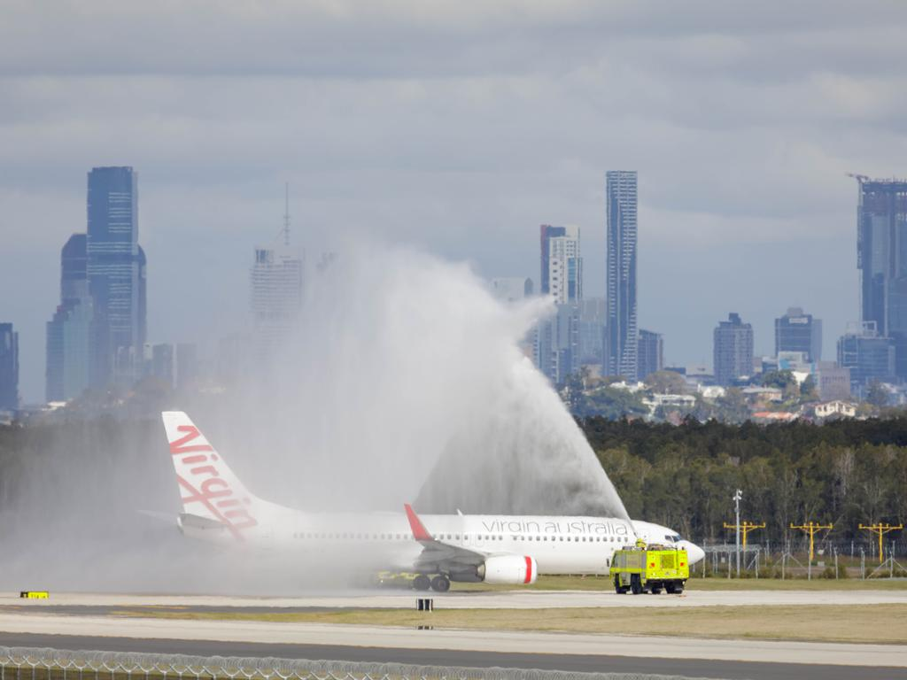 The Virgin Australia 737 is given a water cannon salute before taking off. Picture: Brisbane Airport