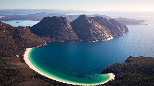 9/71Wineglass Bay, Freycinet National Park - Tasmania With its curves and surrounding bushland, Wineglass Bay in Freycinet National Park is one of the world's most recognisable and famous beaches. Top it off with a stay at Saffire Freycinet afterwards, but read our review first. Picture: Tourism Australia