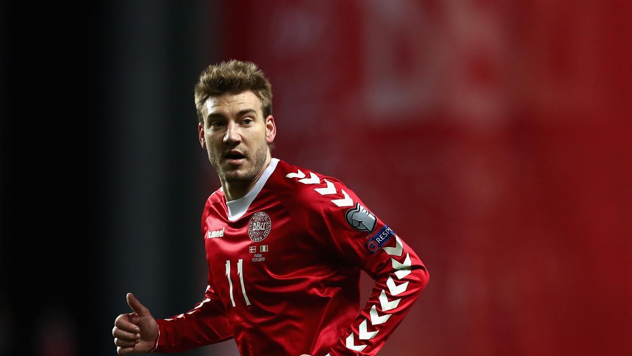 Nicklas Bendtner of Denmark looks on