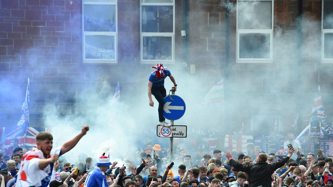 Rangers fans celebrate outside Ibrox Stadium 2021, after lifting the Scottish Premiership trophy for the first time in 10 years.