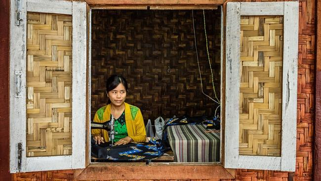 A woman works at an old sewing machine in Yangon. Picture: iStock