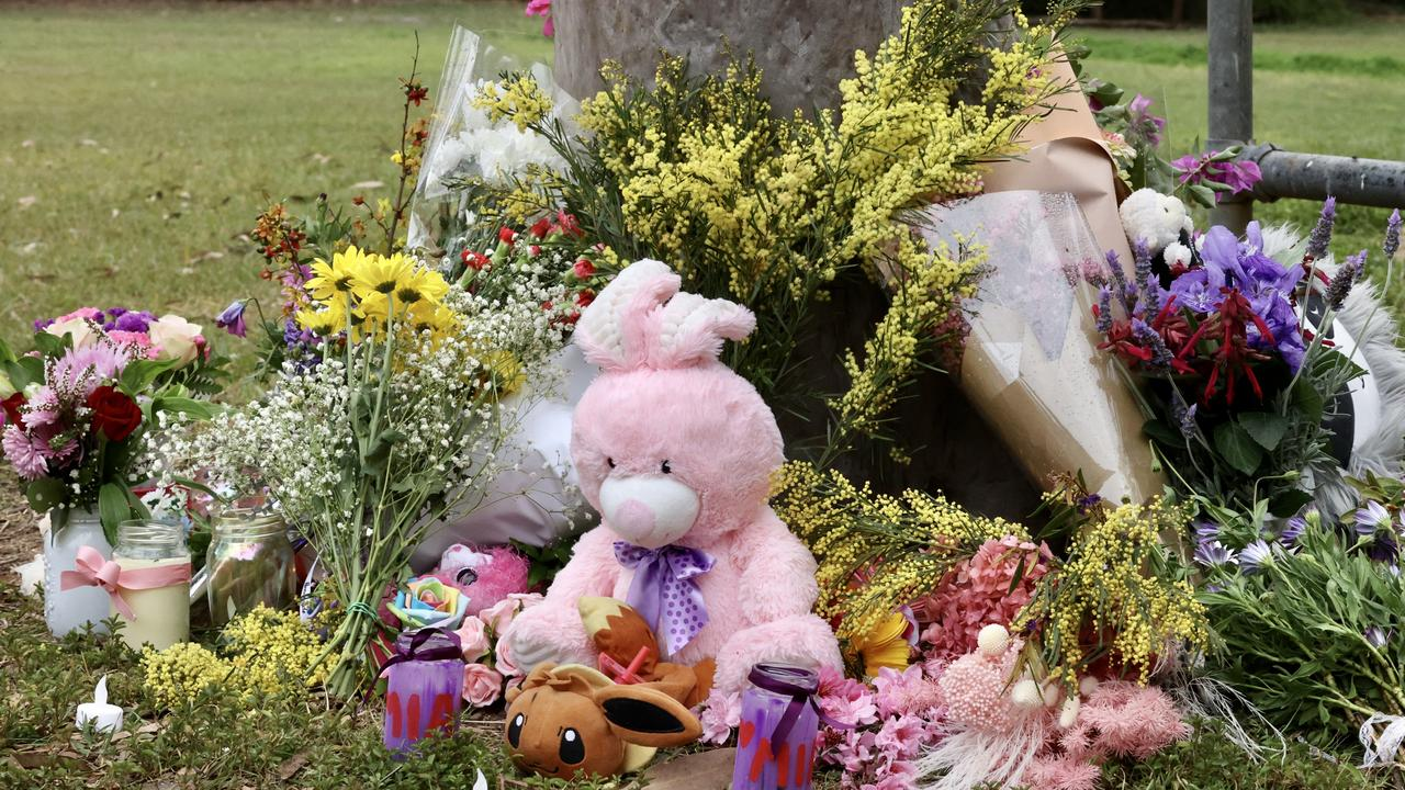 Flowers and toys at the memorial for Mia at Glindemann Park, Holland Park. Picture: Liam Kidston.