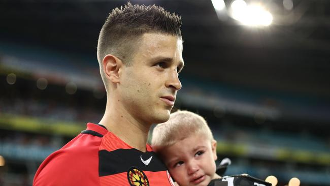 Nicolas Martinez walks out with his son before the round 26 clash against Melbourne Victory. Picture: Getty Images