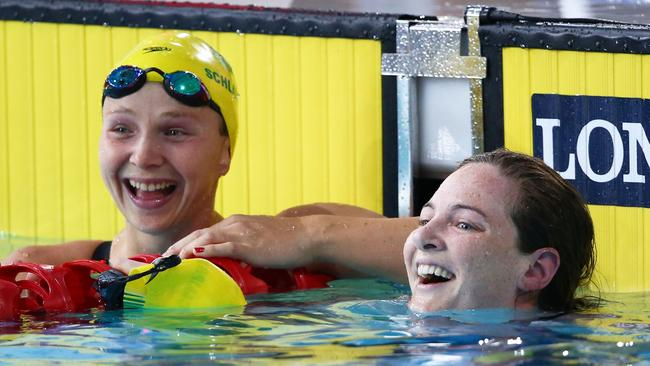 Cate Campbell and Melanie Schlanger compete in the 50m freestyle heats at the Commonwealth Games.